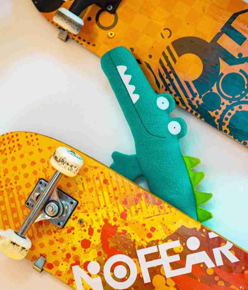 Stuffed crocodile with skateboards