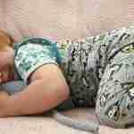 Baby sleeping with stuffed dog toy