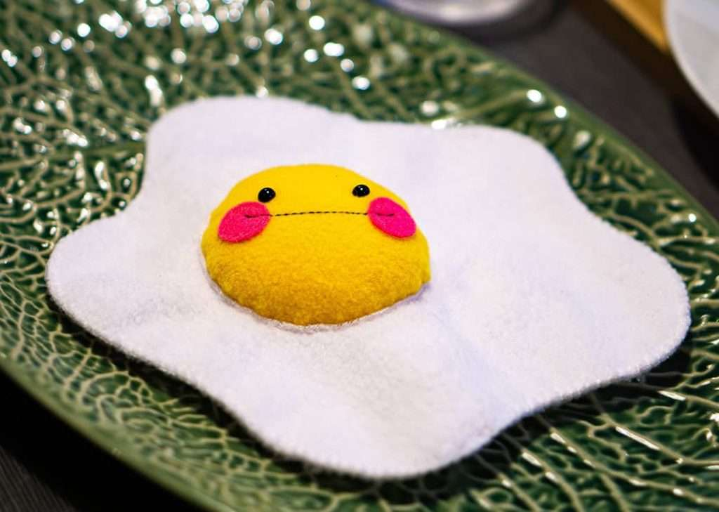 Fried egg toy on the playe