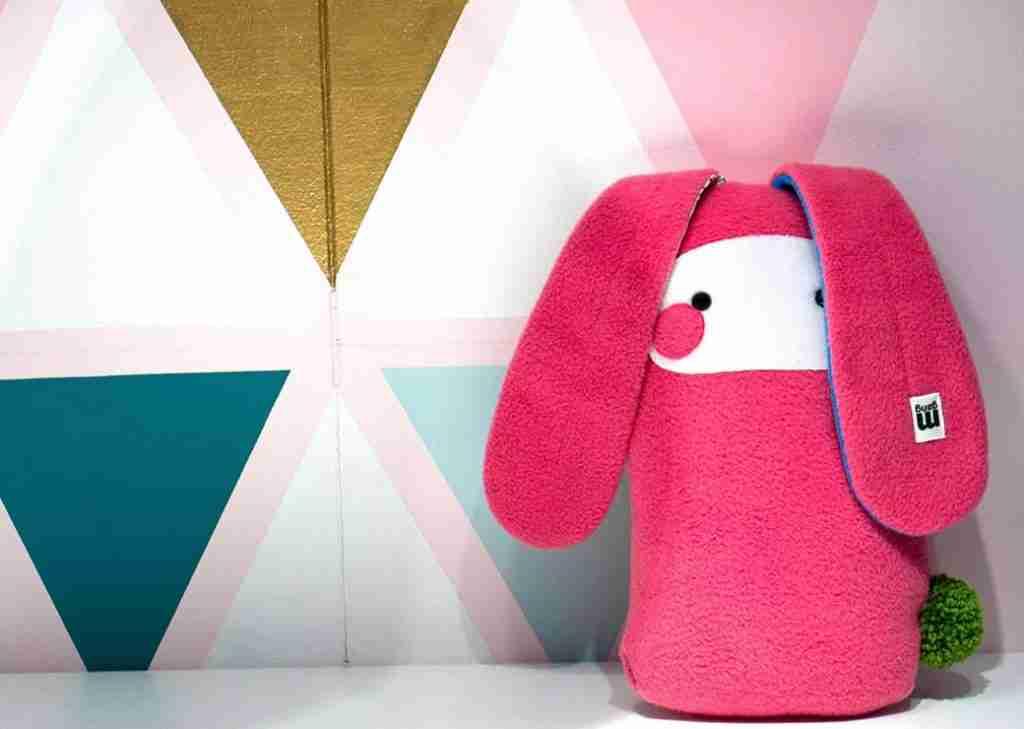 Pink stuffed rabbit nursery decor