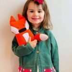 girl with soft fox toy