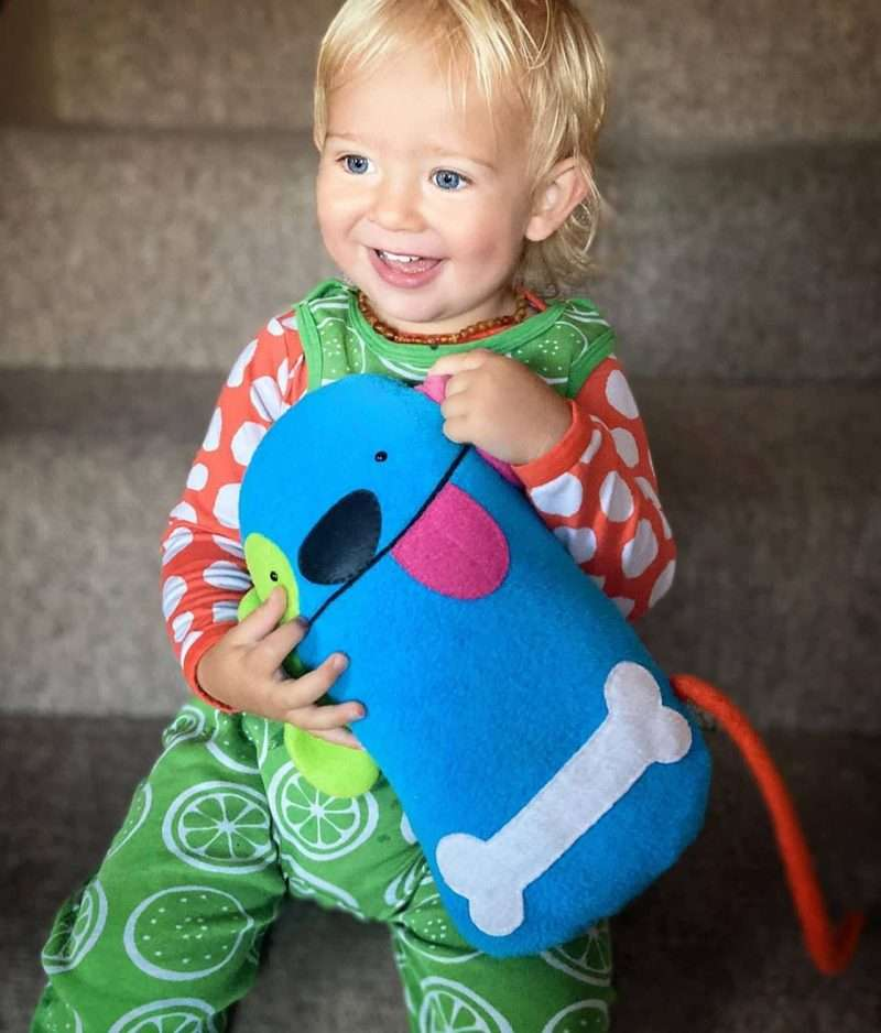 Happy baby with Jimmy stuffed dog toy