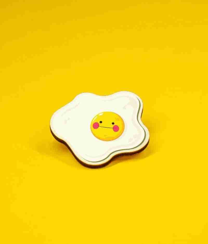 Cute egg in bagde